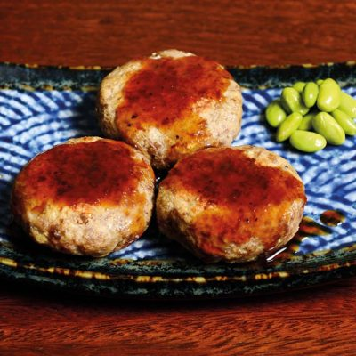 Three small homemade patties made of beef, pork, soy pulp (okara) and tofu with homemade Japanese sauce (each additional piece +2,60€)