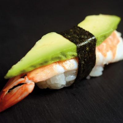 Nigiri with boiled shrimp and a slice of avocado on top