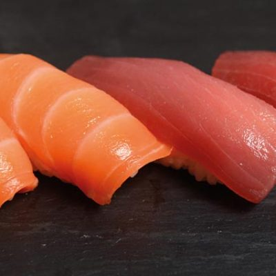 A pair of salmon nigiri and a pair of tuna nigiri