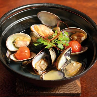 Steamed Japanese clams with sake and broth of bonito. Served with cooked cherry tomato and red pepper strings
