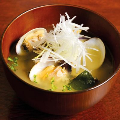 Miso soup with Japanese clams, tofu, carrot and onion