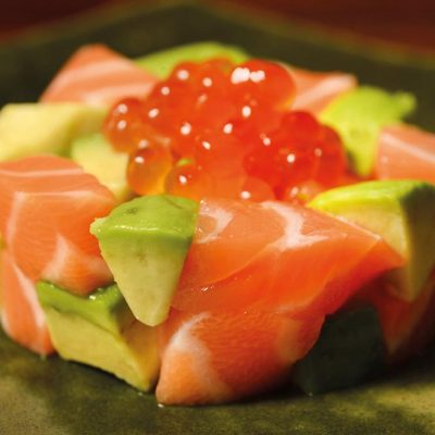 Dices of salmon sashimi and avocado and salmon roe