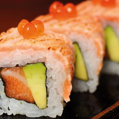 Filled with salmon and avocado and covered with seared salmon, and salmon roe on top