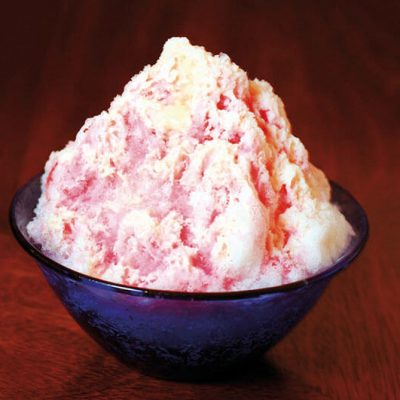 Shaved ice with strawberry syrup and condensed milk