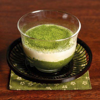 Base of homemade green tea cake, homemade mascarpone cream and Matcha powder on top