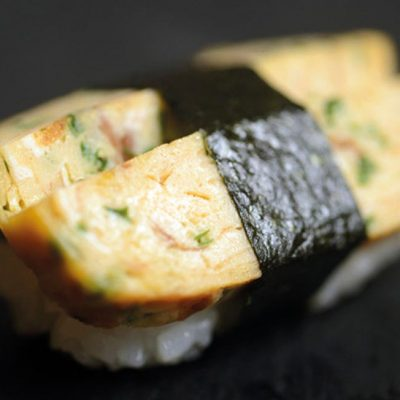 Nigiri with Japanese omelet on top wrapped