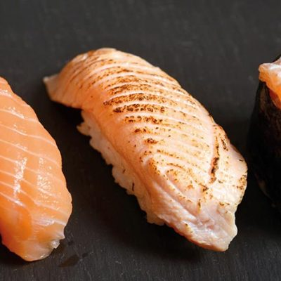 Salmon trio comes with salmon nigiri, seared salmon nigiri and salmon gunkan