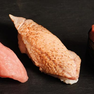 Toro is the fatty part of wild tuna, here a torro nigiri, a seared toro nigiri and a toro gunkan. Seasonal dish