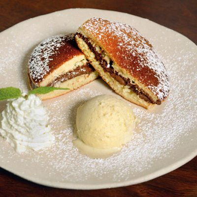 Homemade dorayaki filled with Nutella and served with vanilla icecream
