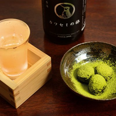 Set of a glass of Japanese sake, Kawasemi no Tabi, with homemade green tea truffles