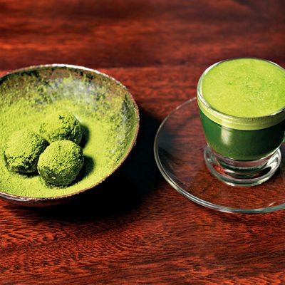 Set of a Matcha Espresso with homemade truffles made of black chocolate and a bit of sake covered with green tea powder